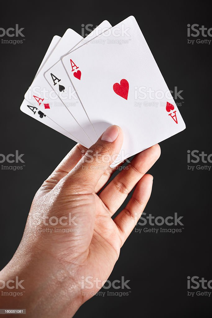Hand holding Aces stock photo