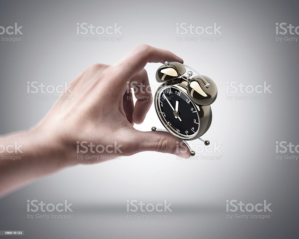 hand holding Alarm clock royalty-free stock photo