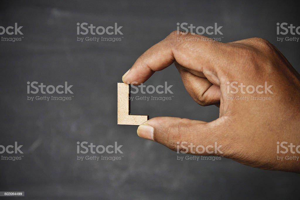 Hand holding alphabet stock photo