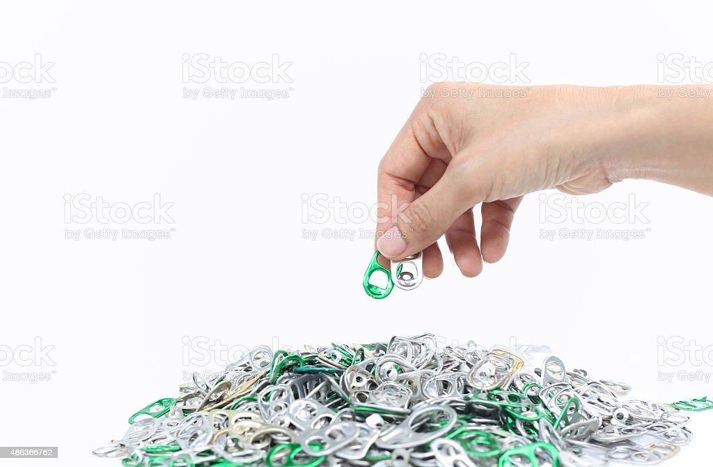 Hand holding aluminium cap can isolated stock photo