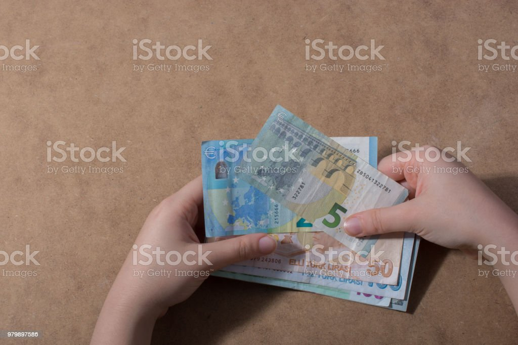 Hand holding American dollar  isolated on wooden background stock photo