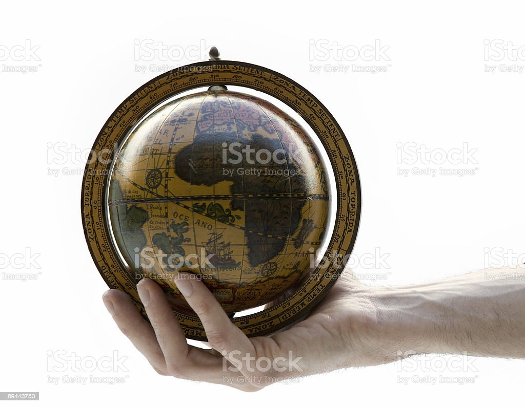 hand holding an antique earth globe royalty-free stock photo