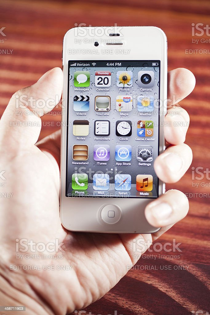 hand holding an apple iphone 4s royalty-free stock photo