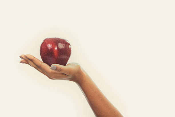 Hand Holding an Apple stock photo