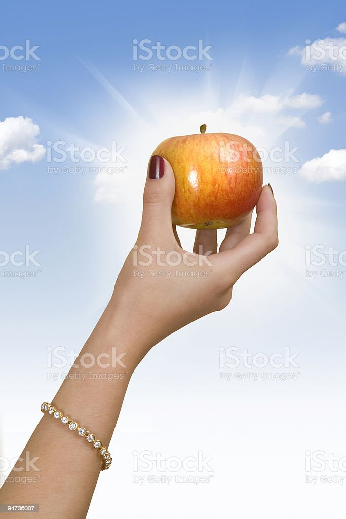 Hand holding an apple royalty-free stock photo
