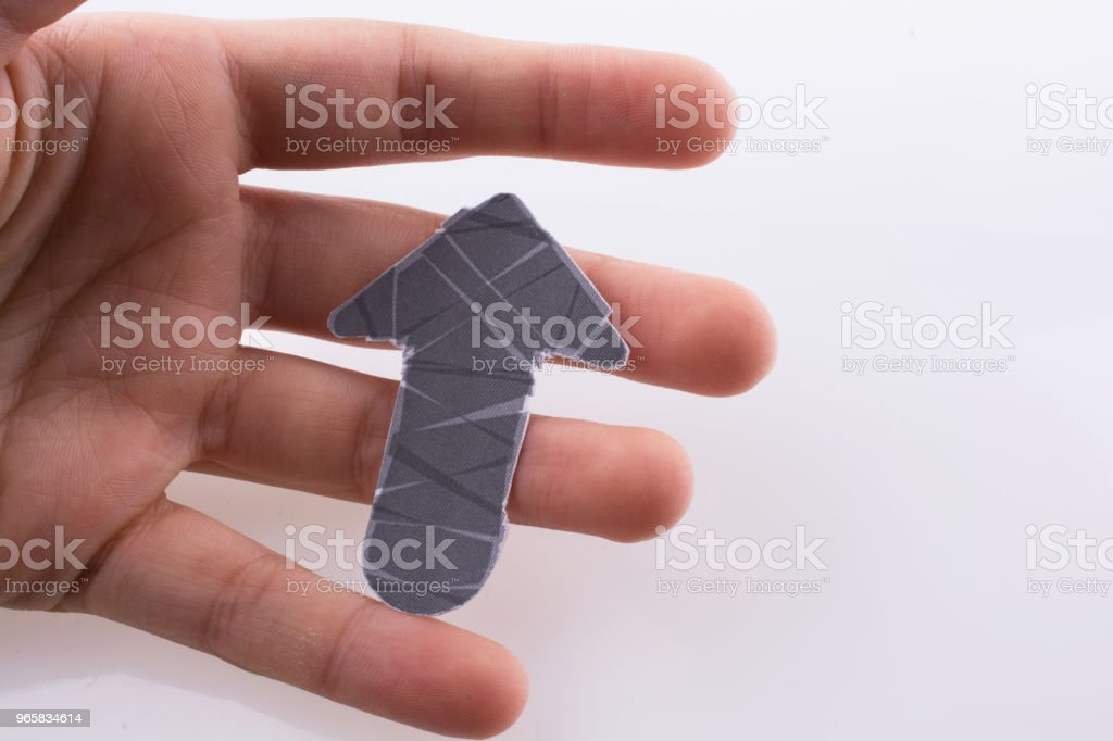 Hand holding an arrow - Royalty-free Direction Stock Photo
