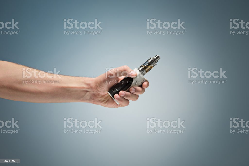 Hand holding an electronic cigarette stock photo