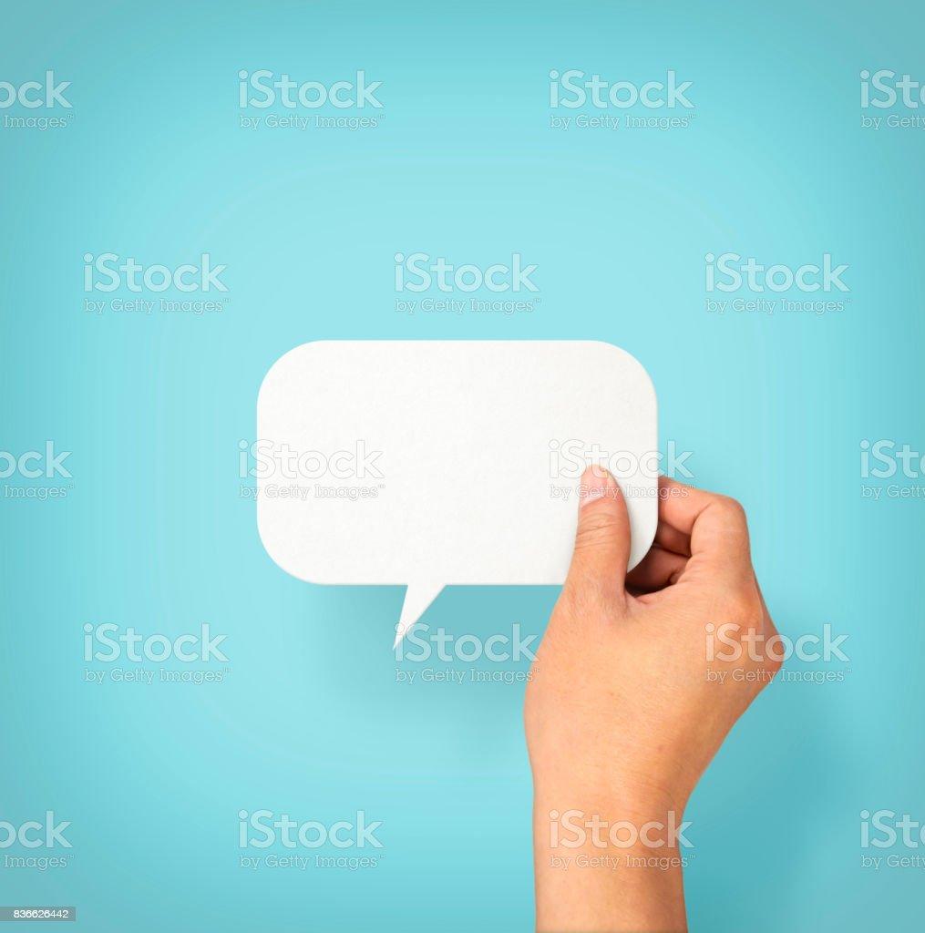 Mão segurando um balão vazio - foto de acervo