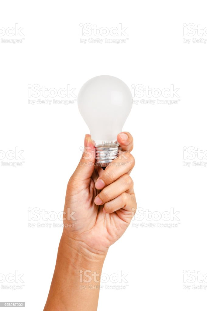 Hand holding an incandescent light bulb stock photo