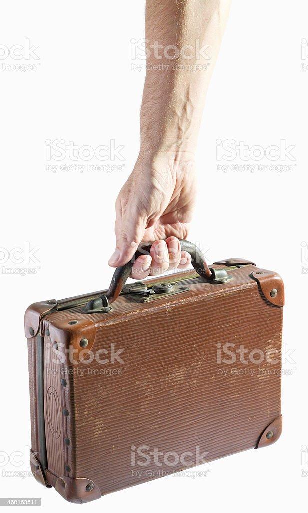Mão segurando a mala de couro antigo - foto de acervo