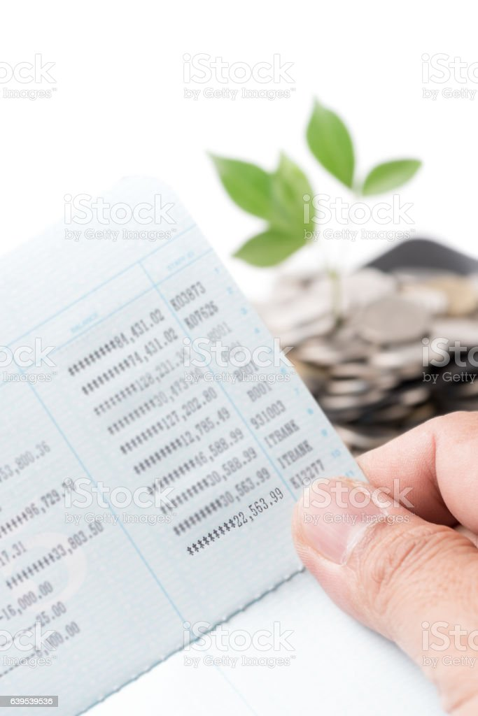 hand holding bankbook or passbook isolated on white stock photo