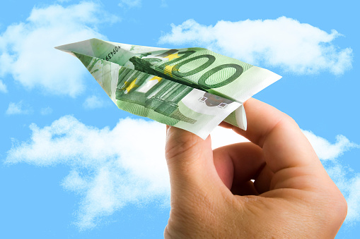 istock Hand Holding Banknote Paper Plane in making money and financial 520842045