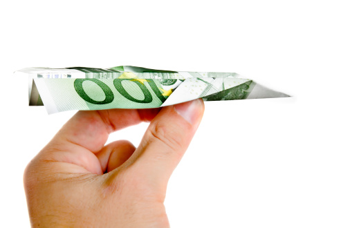 istock Hand Holding Banknote Paper Plane 179028628