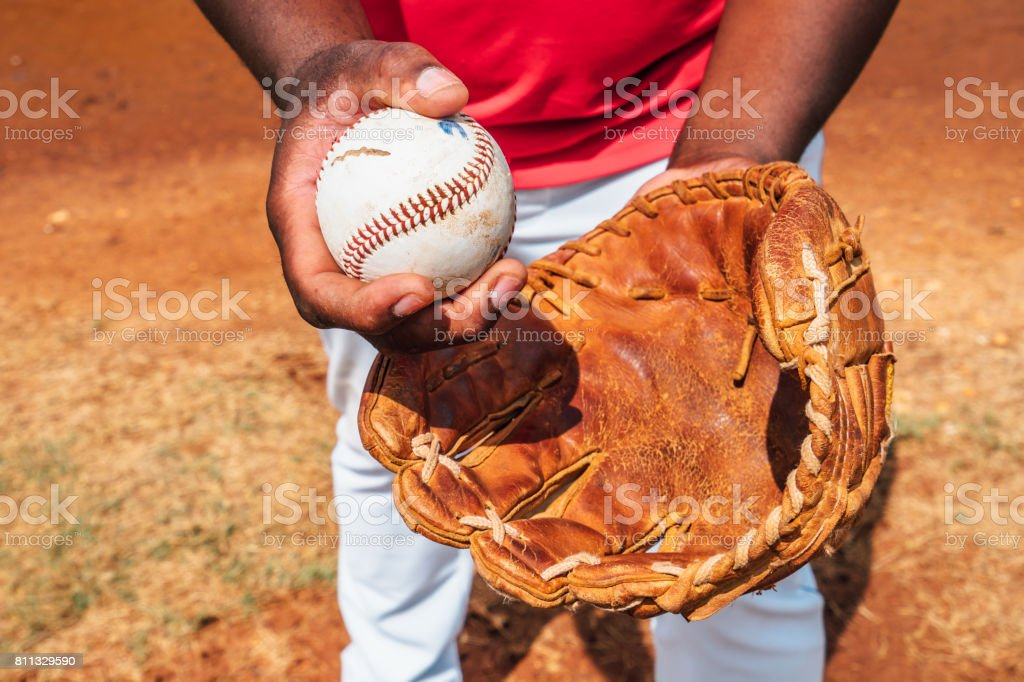 Hand holding baseball stock photo