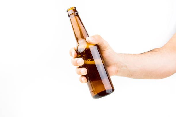 hand holding bierflasche - partylabels stock-fotos und bilder