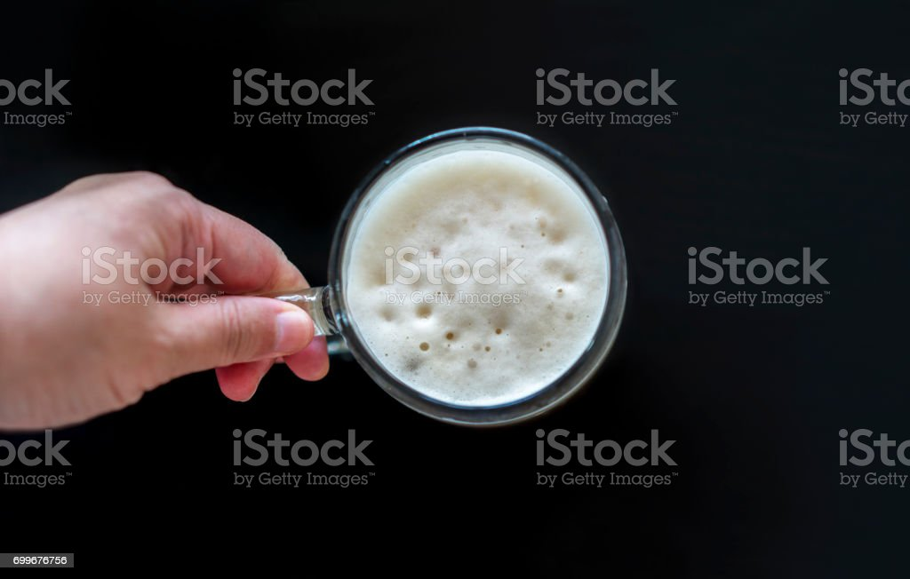hand holding beer mug stock photo