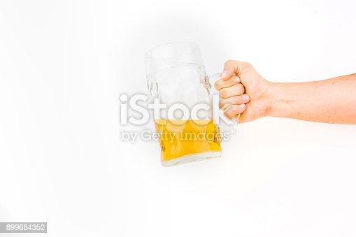 1144550840istockphoto Hand Holding Big Mug Of Light Beer 899684352