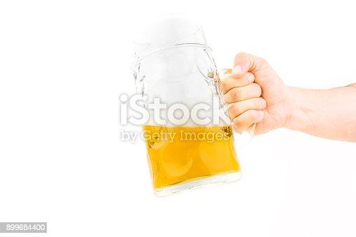 1144550840istockphoto Hand Holding Big Mug Of Light Beer 899684400