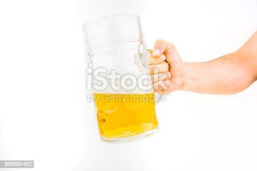 1144550840istockphoto Hand Holding Big Mug Of Light Beer 899684452