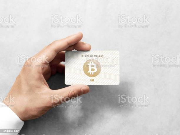 Hand holding bitcoin card template with embossed gold logo picture id954367142?b=1&k=6&m=954367142&s=612x612&h=qkqthhl2dnst bnue1d7wfmla4638w4r78ux fchanm=