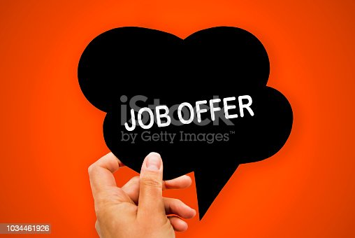 1153648747 istock photo Hand holding black paper speech bubble with JOB OFFER concept, over orange background, isolated. 1034461926