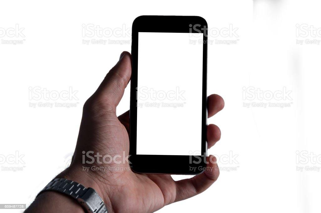 Hand hält schwarz Telefon auf weißen Beschneidungspfad innen isoliert – Foto