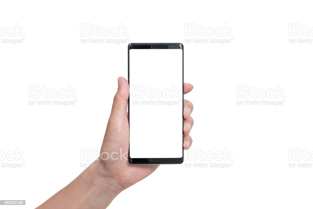 hand holding black smartphone isolated on white clipping path inside royalty-free stock photo
