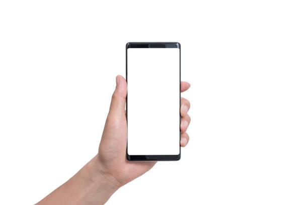 mano que sostiene el smartphone negro aislado en el trazado de recorte blanco interior - foto de stock