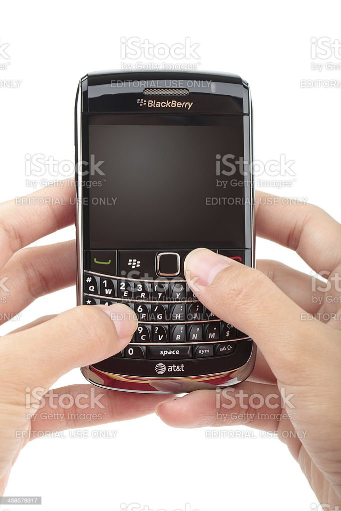 Hand holding blackberry bold texting on a isolated backround royalty-free stock photo