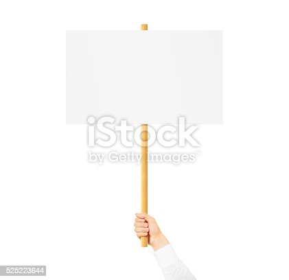 istock Hand holding blank banner mock up on wood stick isolated 525223644