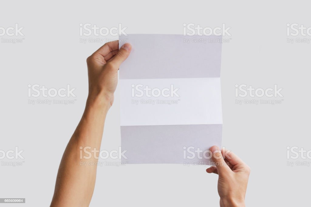 Hand holding blank brochure booklet in the hand. Leaflet presentation. Pamphlet hand man. Man show offset paper. Sheet template. Book in hands. Booklet folding design. Fold paper sheet display read. foto stock royalty-free