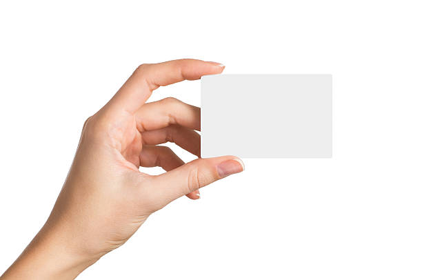 hand holding blank business card - gift voucher or card stock photos and pictures