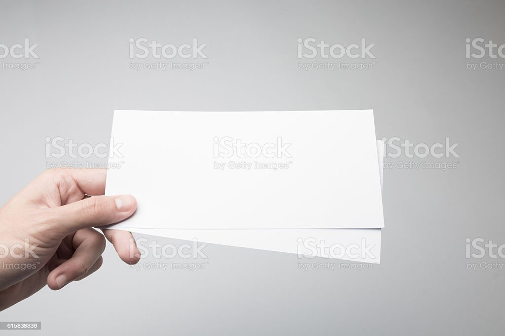 Hand holding Blank DL Flyer / Invitation Mock-up. stock photo