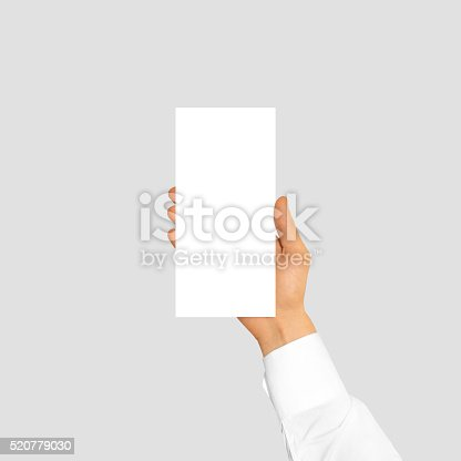 1139340462 istock photo Hand holding blank flyer brochure booklet in the hand 520779030