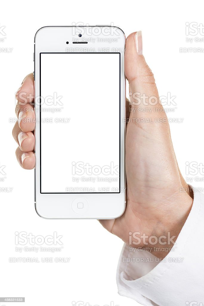 Hand holding blank iPhone 5 royalty-free stock photo