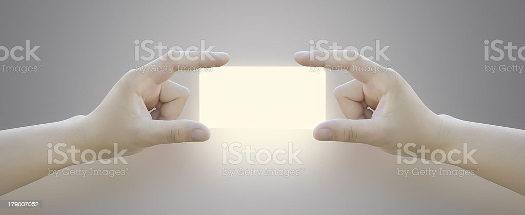 Hand holding blank paper label or tag royalty-free stock photo