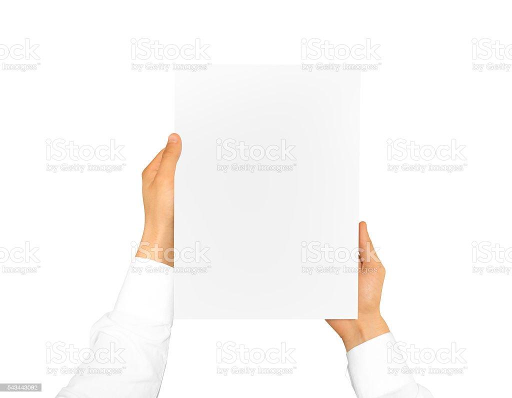 Hand holding blank paper sheet. Corporate letterhead stock photo