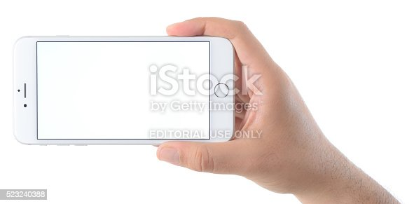 İstanbul, Turkey - April 7, 2016: Man hand holding an Apple iPhone 6 Plus displaying blank white screen. The iPhone 6 Plus is a touchscreen smartphone developed by Apple Inc.