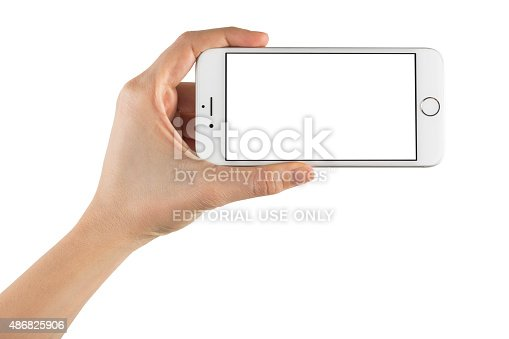 istock Hand Holding Blank Screen Smart Phone on White Background 486825906