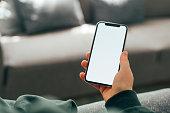 istock Hand Holding Blank Smartphone 1216152134