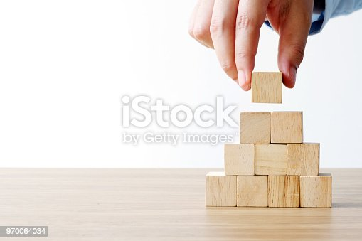 istock Hand holding blank wooden cubes, business concept background, mock up, template 970064034