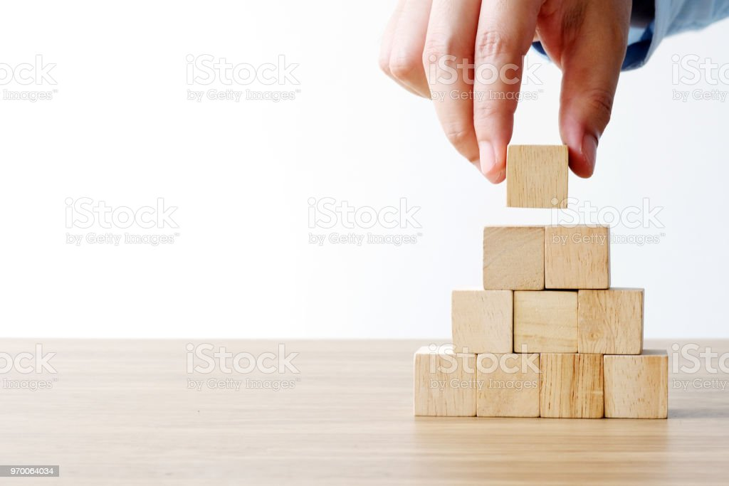 Hand holding blank wooden cubes, business concept background, mock up, template stock photo