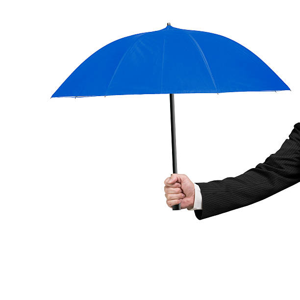 Hand holding blue umbrella stock photo