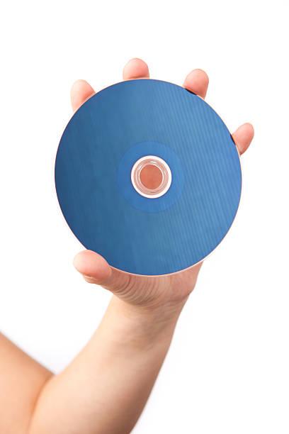 main tenant lecteur blu-ray - blu ray disc photos et images de collection
