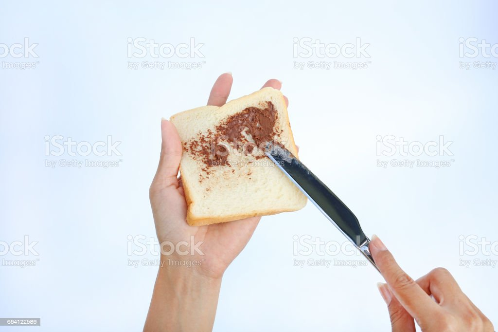 Hand holding bread and Chocolate . foto stock royalty-free