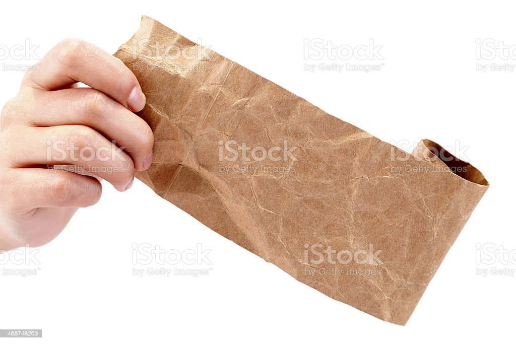 Hand Holding Brown Crumpled Paper stock photo