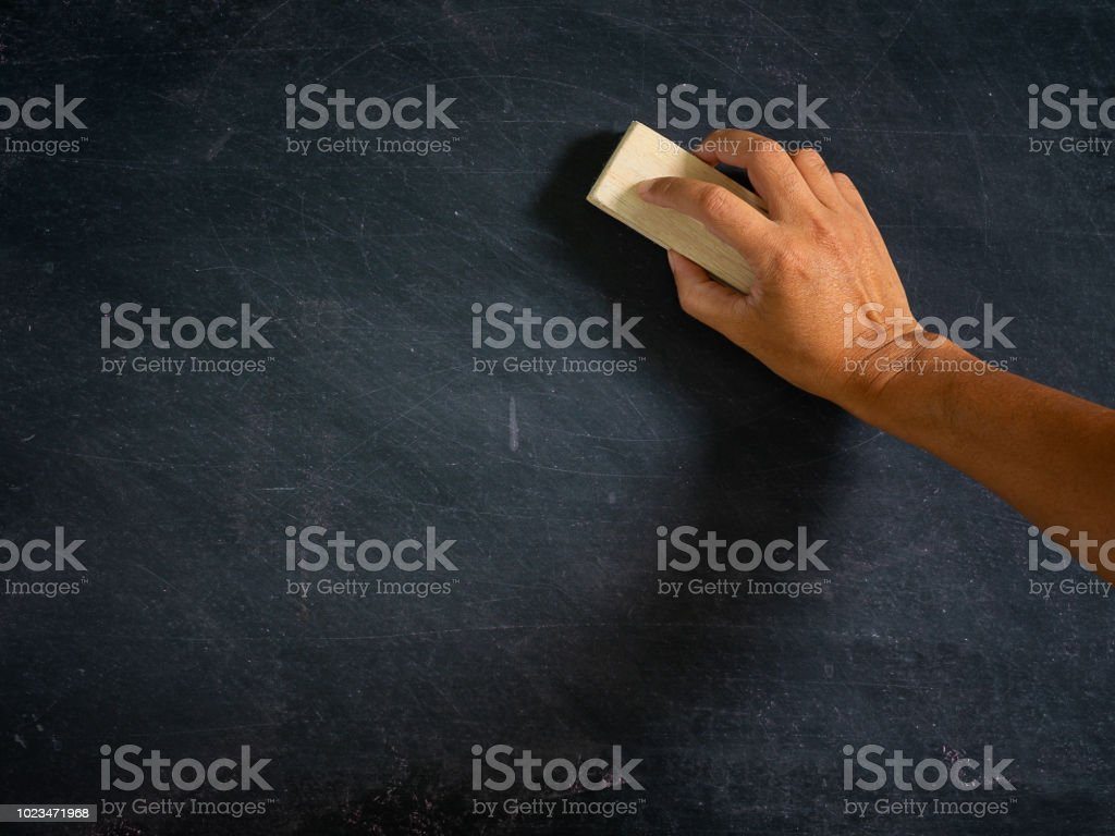 Hand holding brush eraser and blackboard , Concept education and...