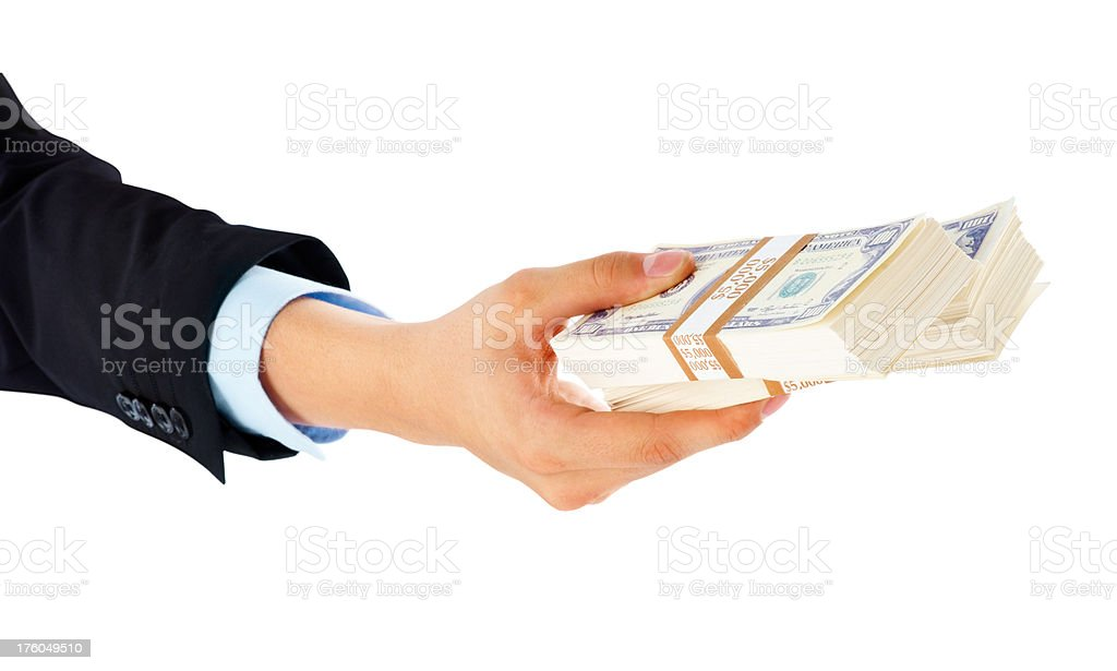 Hand holding bundles of dollars isolated royalty-free stock photo