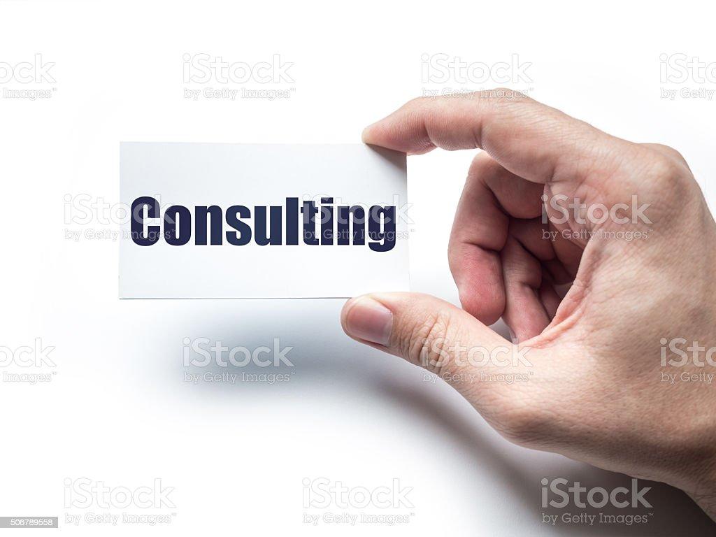 Hand Die Visitenkarte Auf Der Wand Mit Unternehmensberatung