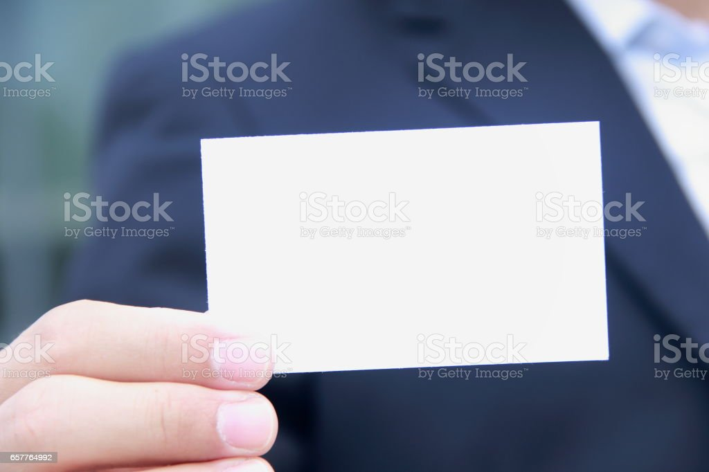 Hand holding business card stock photo